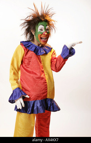Portrait of a joker gesturing and laughing - Stock Image