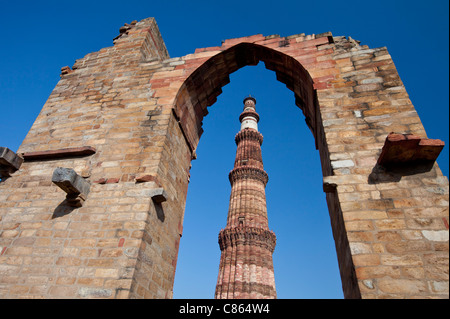 Qutub Minar minaret tower with verses from the Qur'an at Qutab Minar Complex, Unesco World Heritage Site in - Stock Image