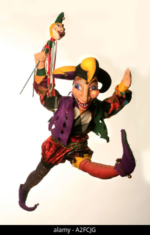 A highly colorful jester or joker puppet - Stock Image