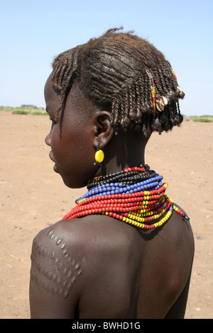 Hairstyle And Tribal Scarring On A Dassanech Tribe Girl, Omorate, Omo Valley, Ethiopia - Stock Image