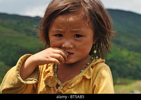 Tribal Black Dao girl near Sapa, Vietnam - Stock Image