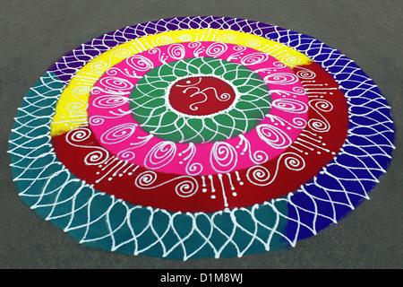 Colorful rangoli, circular designs on the floor during ganesh festival in Pune, Maharashtra, india - Stock Image
