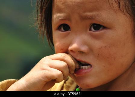 Portrait of young girl near Sapa, Vietnam - Stock Image
