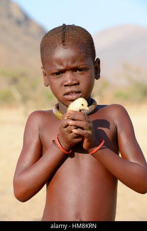 Young Himba girl with the typical necklace. Kaokoland, Namibia. - Stock Image