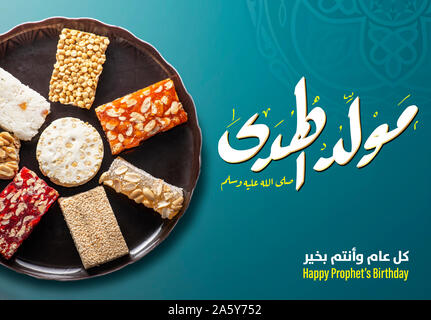 Greeting Card of Traditional Sweets and Arabic Text Saying Bith of The Guider Peace Be Upom Him, Prophet Muhammad Birthday - Stock Image