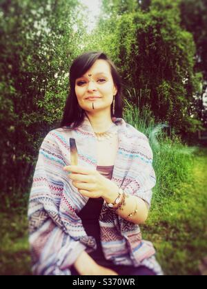 Tribal make-up girl with palo santo - Stock Image