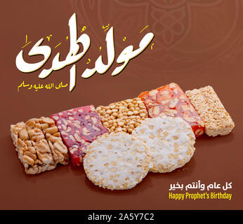 Greeting Card of Traditional Dessert and Arabic Text Saying Bith of The Guider Peace Be Upom Him, Prophet Muhammad Birthday - Stock Image