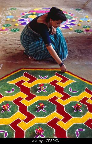 PRG 81263 : indian woman making pattern of Rangoli india MR - Stock Image