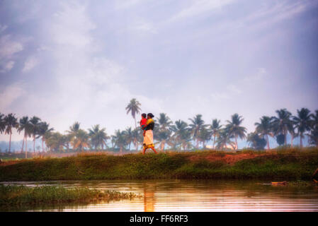 a woman with her baby in Alappuzha, Backwaters, Kerala, South India, Asia - Stock Image
