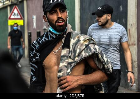 Beirut, Lebanon, 30 October 2020. A protester wearing a Shahada flag saying 'There is no god but Allah and Muhammad is his messenger' during clashes between a small group of men from Tripoli and Beirut and Lebanese Interior Security Forces. Pan-islamic group Hizb Ut Tahrir attempted to march to the French Embassy in protest of what they view as president Emmanuel Macron's anti-islamic stance. Emotions ran high as it was felt the Prophet Muhammad is being disrespected during his birthday month. Credit: Elizabeth Fitt/Alamy Live News - Stock Image