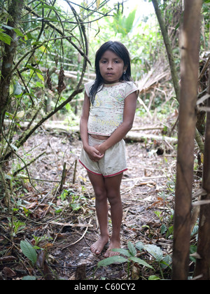 A young tribal girl deep in the Amazon Jungle. Shuar tribe. - Stock Image