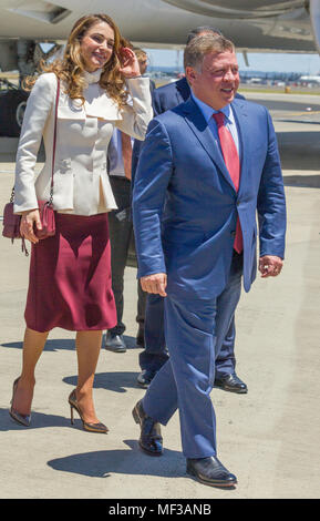 Their Majesties King Abdullah II bin Al-Hussein and Queen Rania Al-Abdullah of the Hashemite Kingdom of Jordan arrive into Sydney Airport as part of their State Visit to Australia in November 2016. Abdullah II bin Al-Hussein (born 30 January 1962) has been King of Jordan since 1999 upon the death of his father, King Hussein of Jordan. King Abdullah II bin Al-Hussein is considered a direct descendant of the Prophet Muhammad through belonging to the ancient Hashemite family. He is also known for promoting peace and interfaith dialogue and is regarded as 'the most influential Muslim in the world' - Stock Image