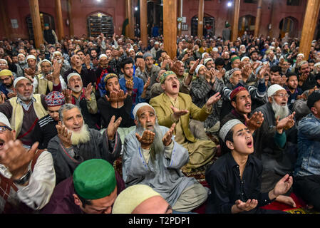 Kashmiri Muslims are seen offering supplications during the occasion of Shab-e-Meraj inside a mosque in Srinagar. Lailat-ul-Meraj also known as Shab-e-Mairaj is a glorious night, marking the Isra and Meraj of Prophet Muhammad (PBUH) when he was taken from Makkah to Al-Haram-Al-Sharif, inside Al-Aqsa Mosque (also known as Baitul Muqaddas) and was then ascended to highest stages of the Heaven. - Stock Image