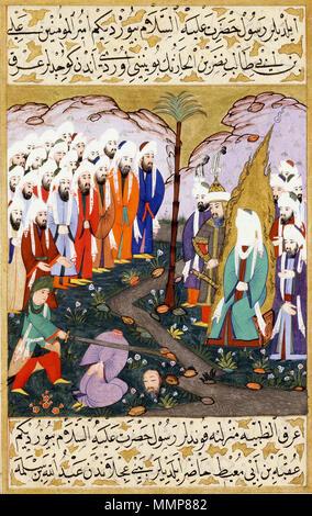 Ali Beheading Nadr ibn al-Harith in the Presence of the Prophet Muhammad. Miniature from volume 4 of a copy of Mustafa al-Darir's Siyar-i-Nabi. Istanbul; c. 1594 The David Col. - Stock Image