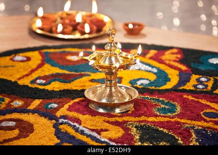Close-up of rangoli with diyas - Stock Image