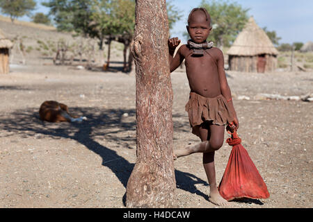 Portrait of himba girl into the village near Opuwo town in Namibia, South Africa - Stock Image