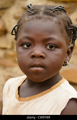 Little girl with tribal scarring on cheek, northern Ghana - Stock Image