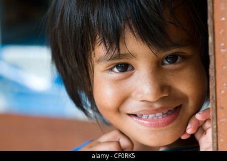 Young girl in shop waikabubak sumba indonesia - Stock Image