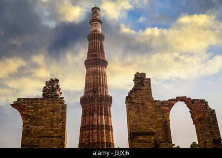 Qutb Minar Delhi is the world's tallest rubble masonry minaret. Qutub Minar and the archaeological ruins form - Stock Image