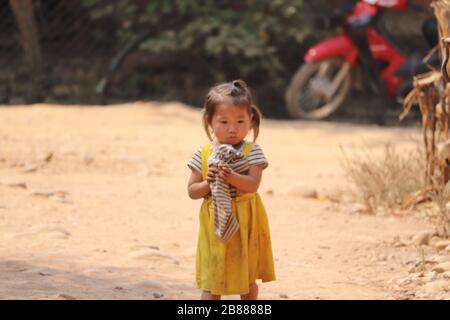 YOUNG TRIBAL GIRL IN A VILLAGE IN LUANG NAMTHA PROVINCE,NORTHERN LAOS. - Stock Image