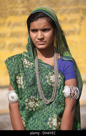 A young tribal girl in traditional dress, Bhil tribe, Jhabua, Madhya Pradesh, India. Rural faces of India - Stock Image