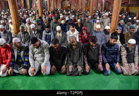 Kashmiri Muslims are seen offering prayers during the occasion of Shab-e-Meraj inside a mosque in Srinagar. Lailat-ul-Meraj also known as Shab-e-Mairaj is a glorious night, marking the Isra and Meraj of Prophet Muhammad (PBUH) when he was taken from Makkah to Al-Haram-Al-Sharif, inside Al-Aqsa Mosque (also known as Baitul Muqaddas) and was then ascended to highest stages of the Heaven. - Stock Image