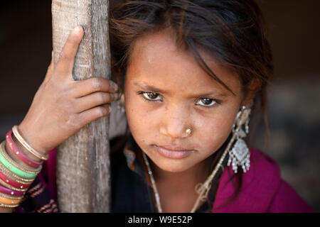 Young tribal girl in a rural village in the district of Kutch, Gujarat. The Kutch region is well known for its tribal life and traditional culture. - Stock Image