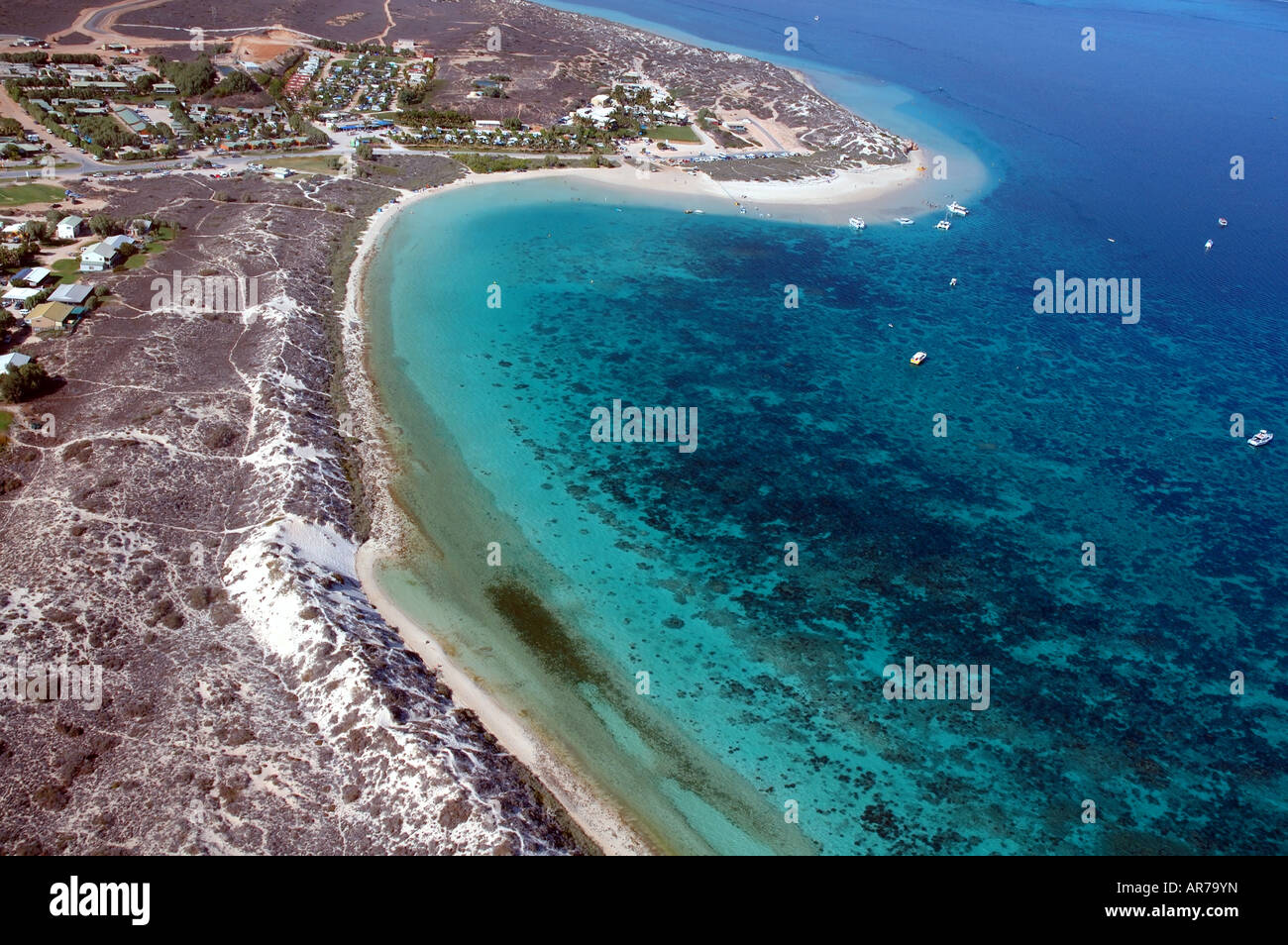 Aerial view of the township boats and reefs of Coral Bay Ningaloo Reef Marine Park Western Australia Stock Photo
