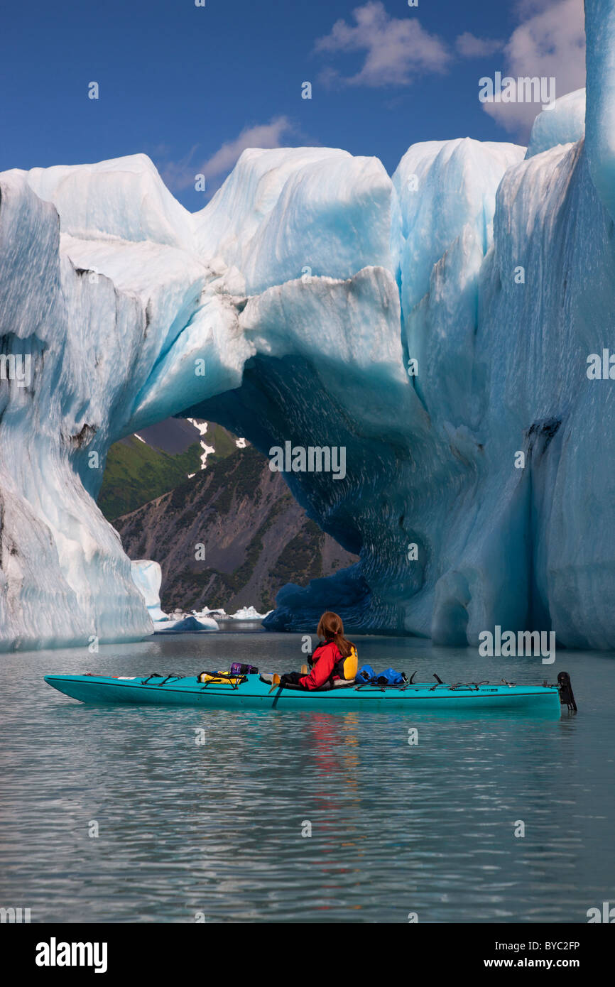Kayaking in Bear Lagoon, Kenai Fjords National Park, near Seward, Alaska. (model released) Stock Photo