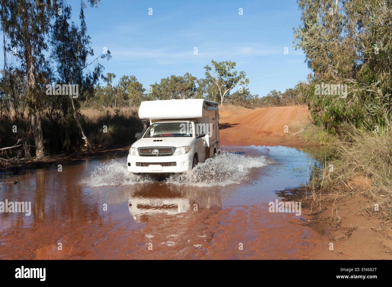 4x4-motorhome-crossing-a-creek-mitchell-