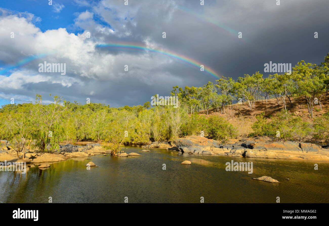 black-clouds-and-rainbow-over-bushland-i