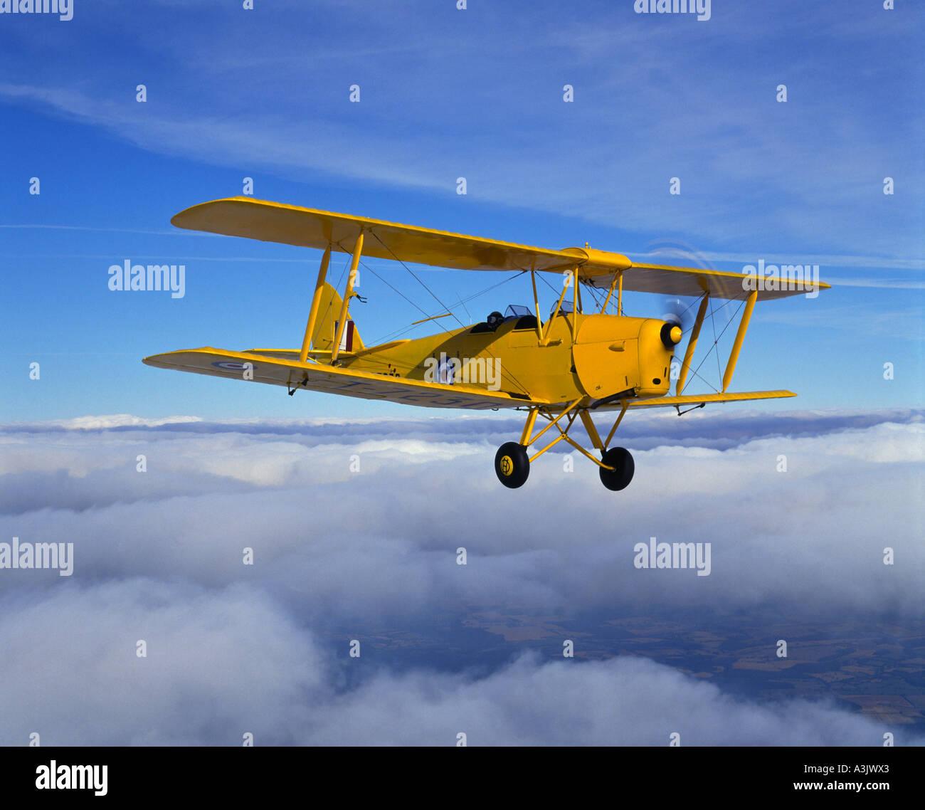 de Havilland Tiger Moth above clouds Stock Photo