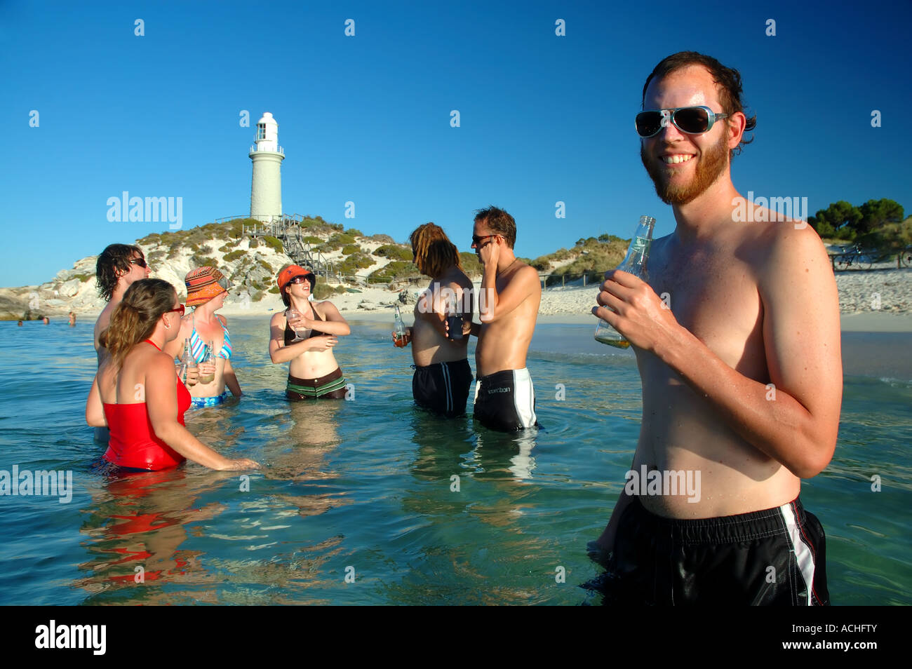 Group of friends enjoying a summer afternoon at the beach Rottnest Island Western Australia MR Stock Photo