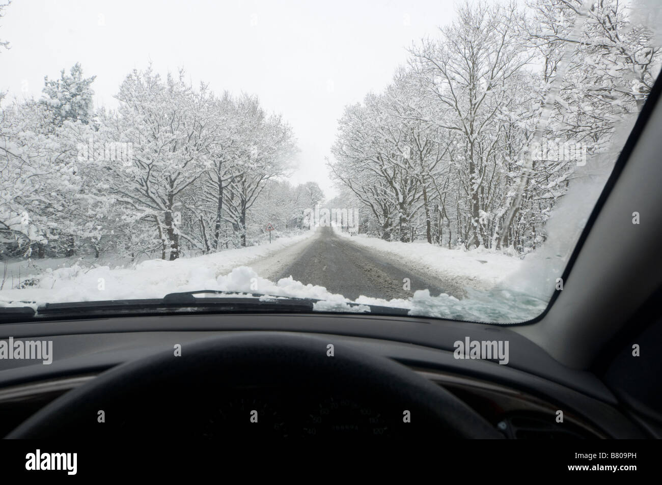 snow-covered-country-road-surrey-uk-B809