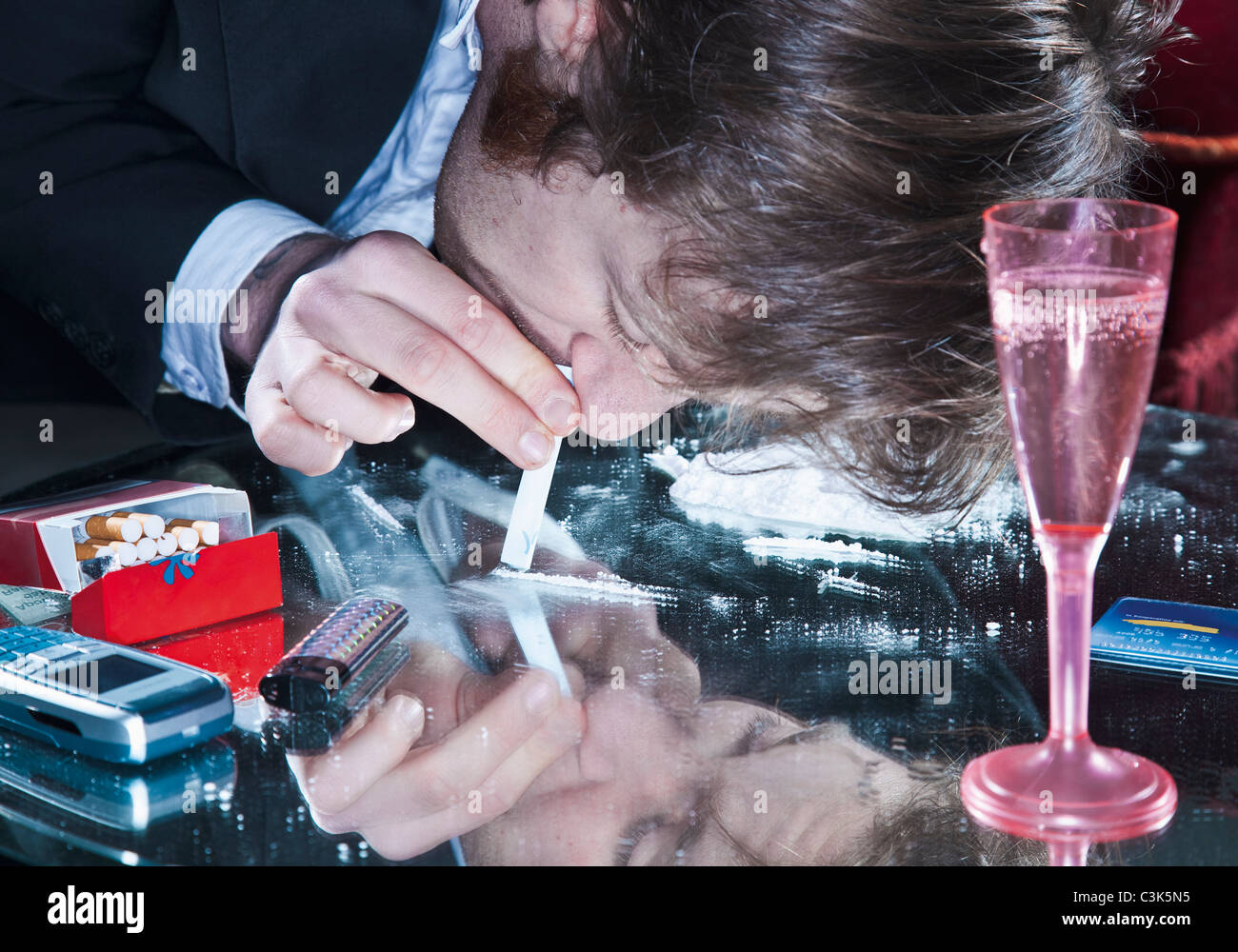 young-man-sniffing-cocaine-C3K5N5.jpg