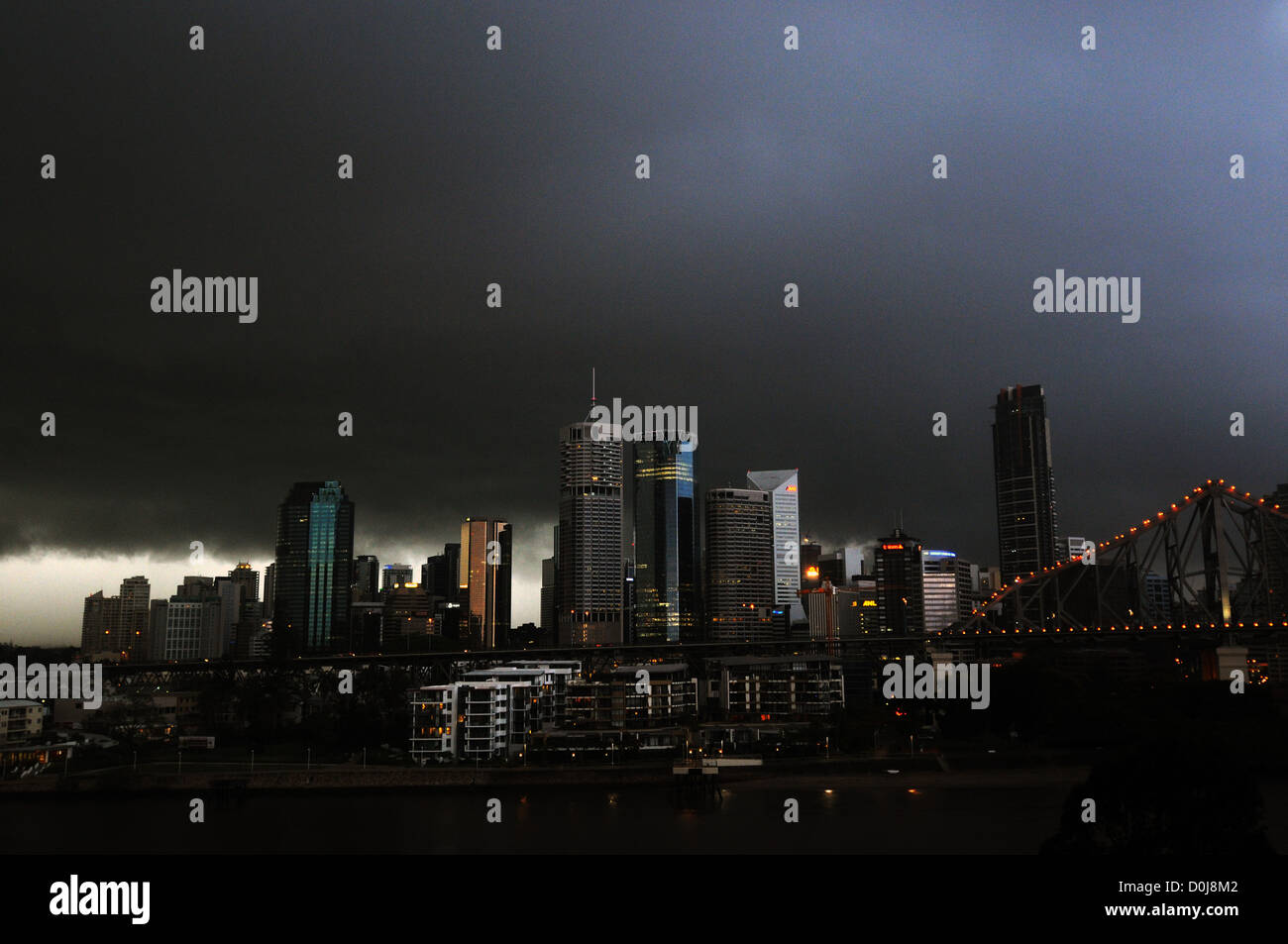 Summer thunderstorm over the city turns day to night... Brisbane, Queensland, Australia. No PR Stock Photo