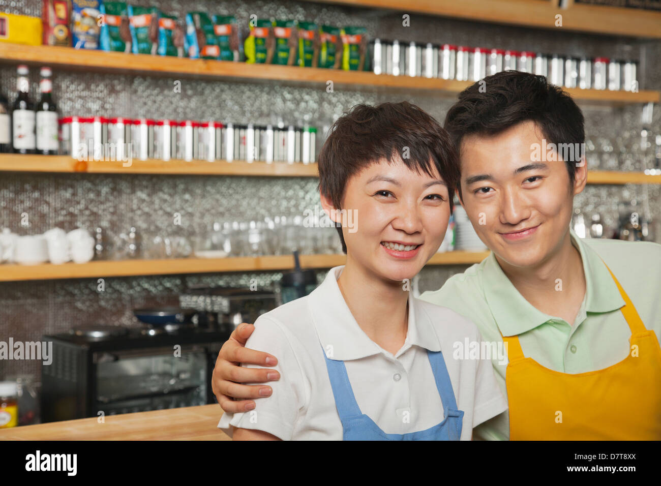 portrait-of-two-baristas-at-a-coffee-sho