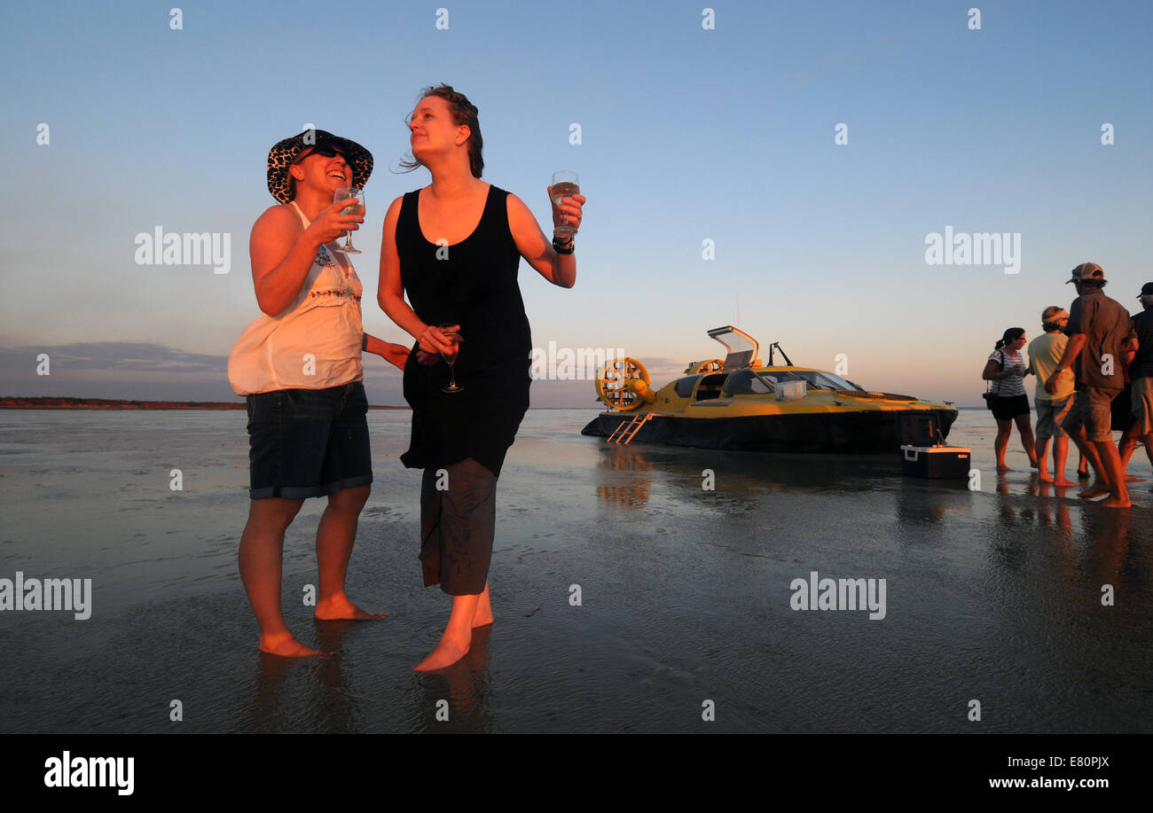 tourists-having-a-sunset-drink-on-low-ti