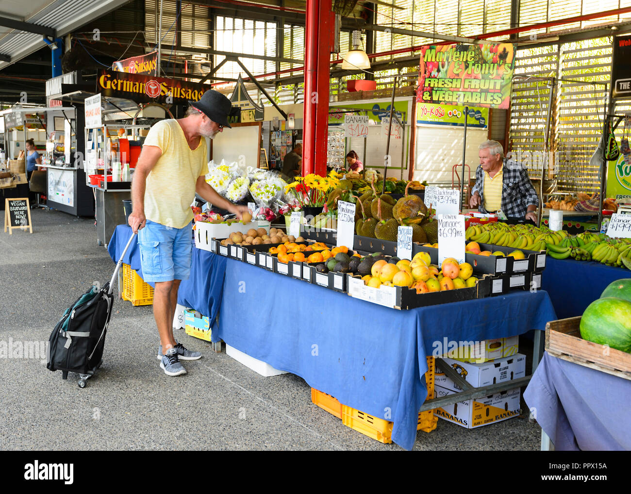 male-customer-examining-fruit-at-the-pop