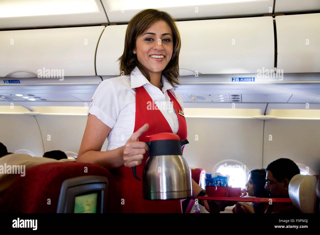 cabin-crew-serving-tea-coffee-passengers