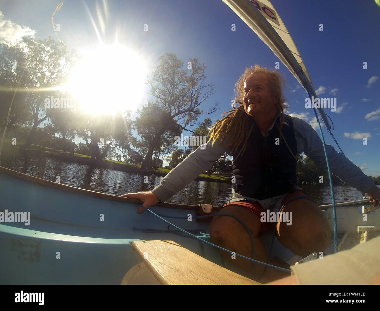 happy-man-sailing-small-dinghy-swan-rive