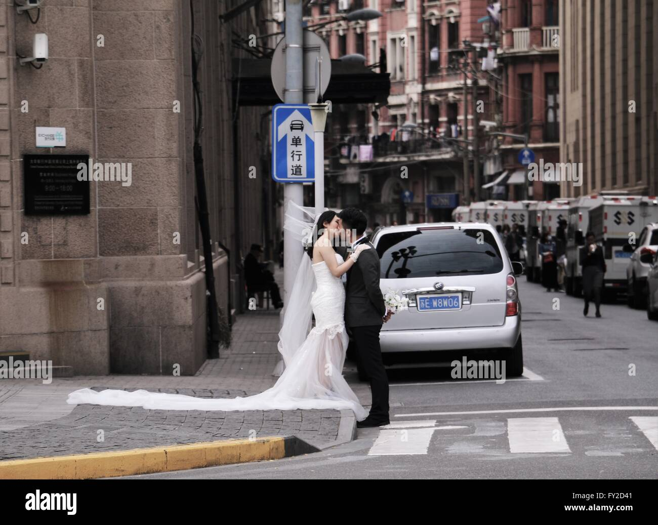 kissing-bride-and-groom-in-the-street-of