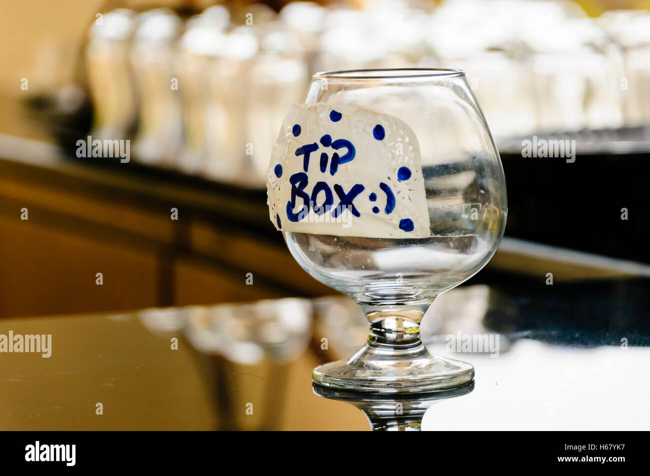a-brandy-glass-tip-box-on-the-counter-of