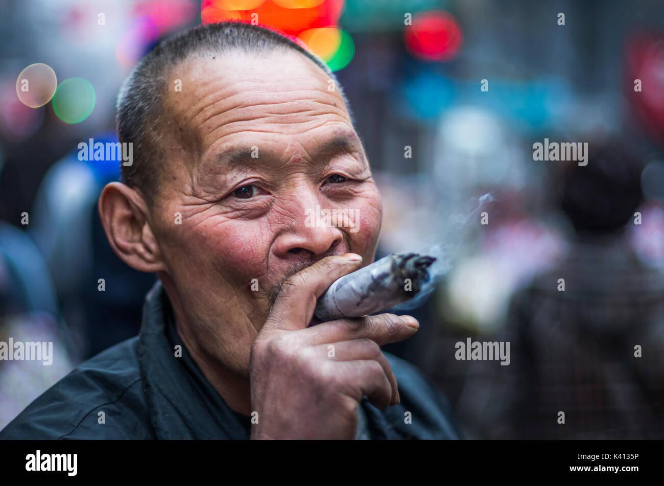 man-in-xian-smoking-a-big-cigar-china-K4