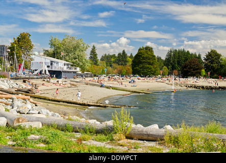 Sunbathers enjoying the sandy beach at Ambleside Park in West Vancouver, British Columbia, Canada. Beautiful summer day. - Stock Image