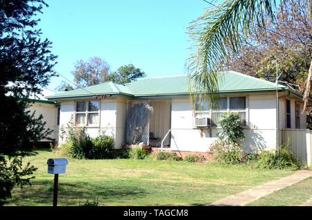Australian Post War fibro-cement Double Fronted home with iron roof. Tamworth NSW. - Stock Image