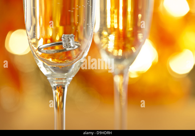 champagne-glasses-with-engagement-jewelr