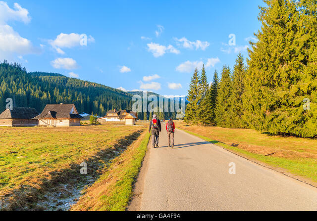 couple-of-tourists-walking-on-road-in-ch