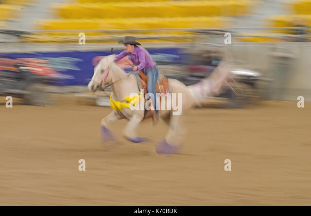 Horse Sports, Ladies National Finals Barrel Race at the Australian Equine and Livestock Events Centre (AELEC) Indoor - Stock Image