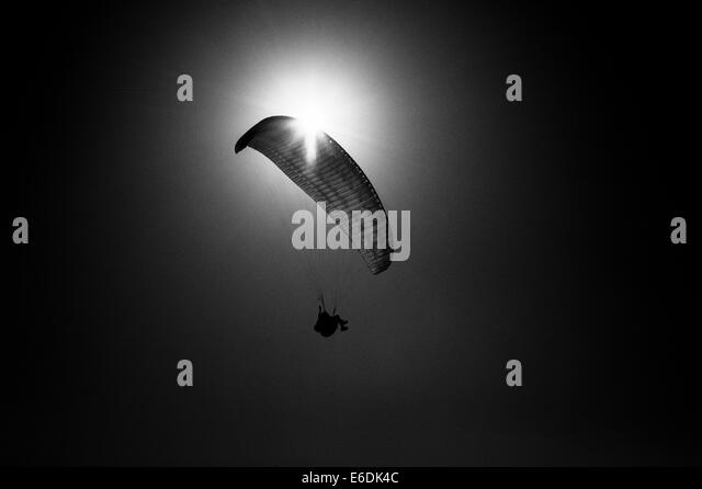 paraglider-flying-over-malta-silhouetted
